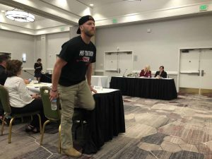 Ryan Miller stands up after submitting public commentary to the Bureau of Cannabis Control, Oakland, August 7 2018